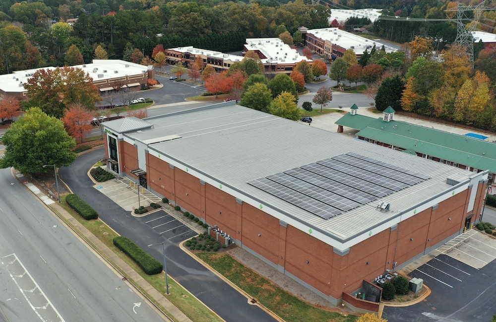 Finished installation of solar array on building- National Self Storage